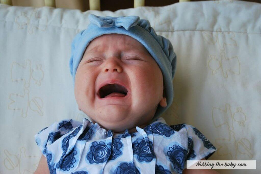 crying baby girl sad infant blue hat